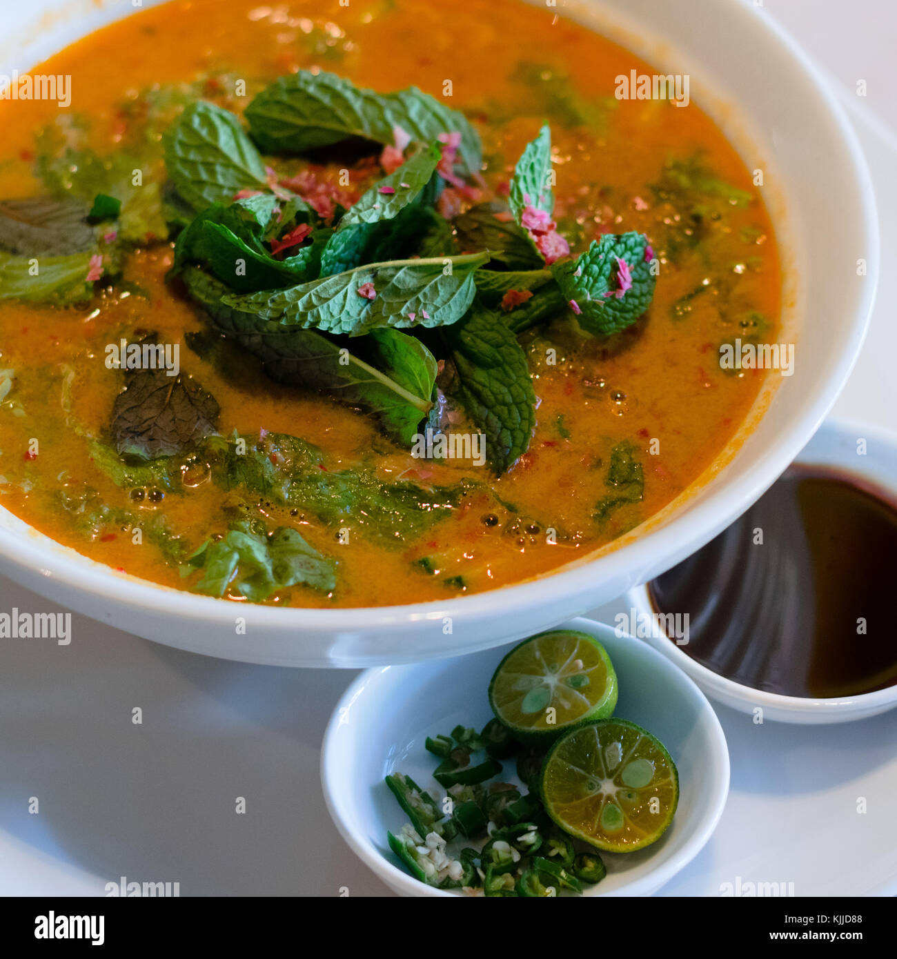 Tom Yum hot and sour soup from Thailand, with lemongrass, kaffir lime, fish sauce, shrimps and crushed chili peppers. Stock Photo