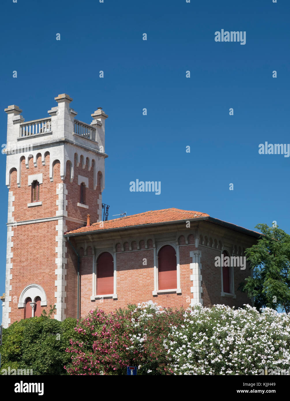 Porto Potenza Picena (Macerata, Marches, Italy): odd old house with tower and flowered garden Stock Photo