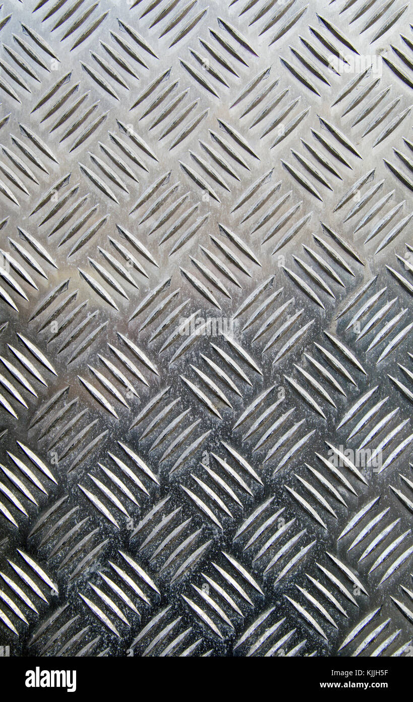 Checker plate steel sheet texture background - Stock Image
