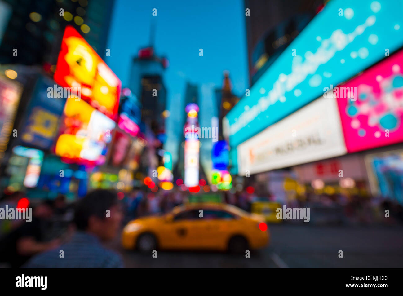 Defocus abstract view of Times Square signage, traffic, and holiday crowds in the lead-up to New Year's Eve - Stock Image