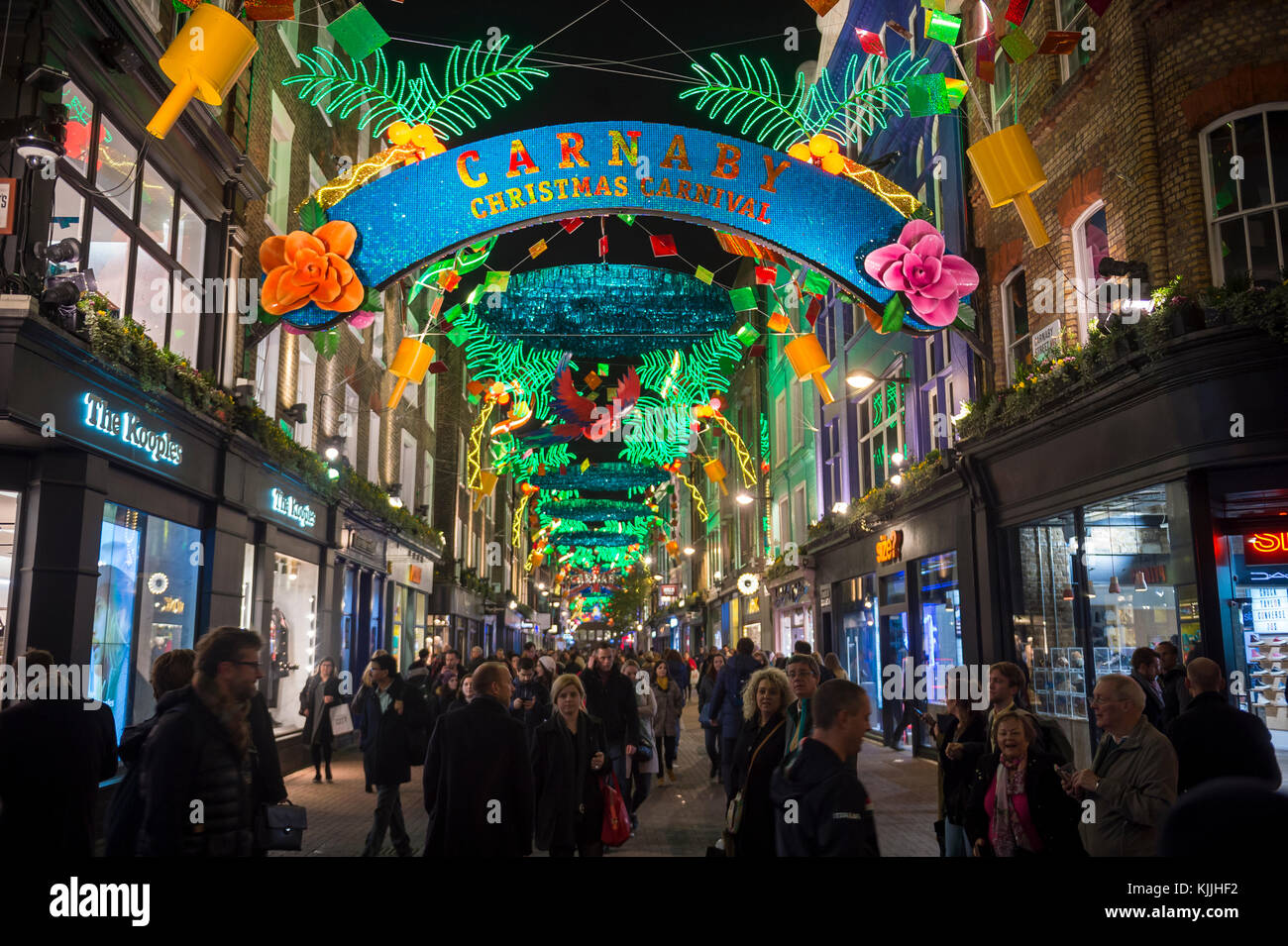 LONDON - NOVEMBER 21, 2017: Colorful Christmas holiday lights decorate Carnaby Street in the west end neighborhood - Stock Image