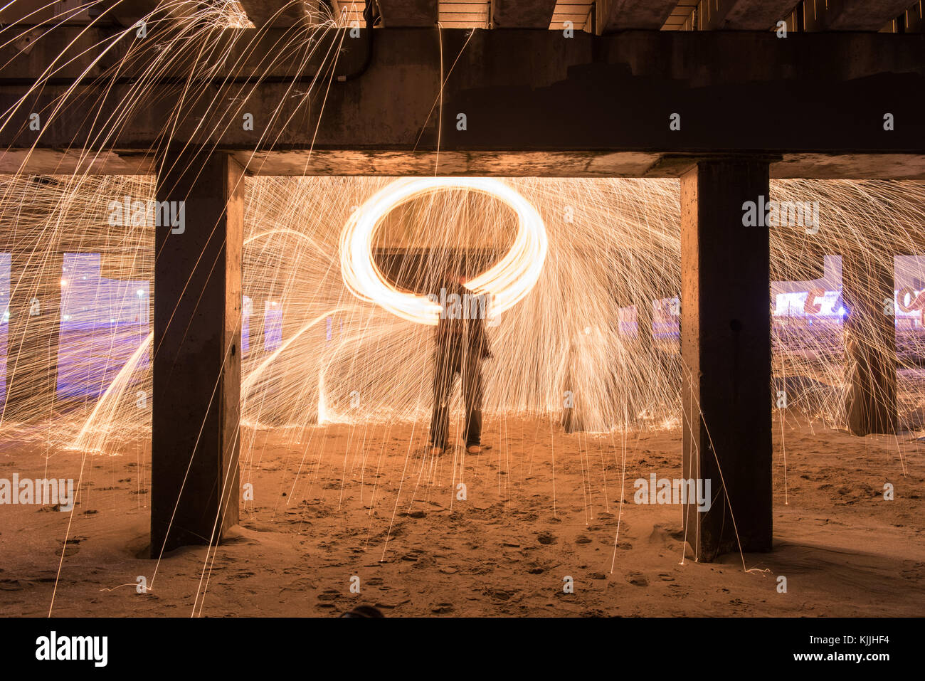 Showers of hot glowing sparks from spinning steel wool at Coney Island Beach, Brooklyn, New York. Stock Photo