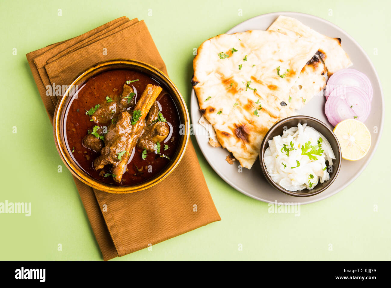 Mutton Masala Or Masala Gosht or indian lamb rogan josh with some seasoning, served with Naan or Roti, selective - Stock Image
