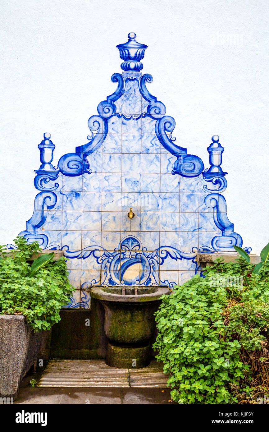 Stone drinking fountain decorated with Portuguese azulejos tiles, Funchal Old Town, Madeira, Portugal - Stock Image