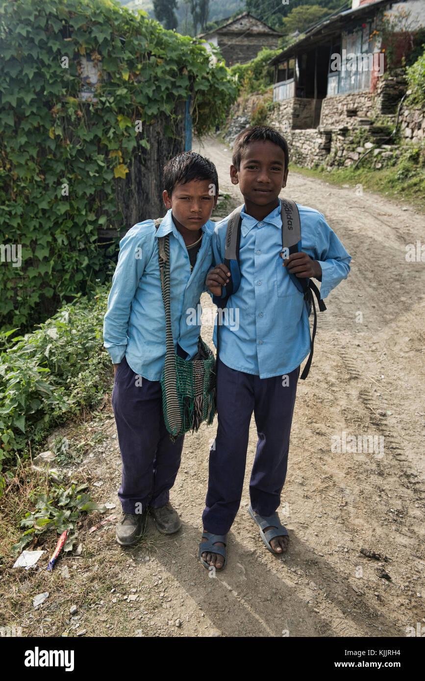Nepali schoolboys, Annapurnas, Nepal - Stock Image
