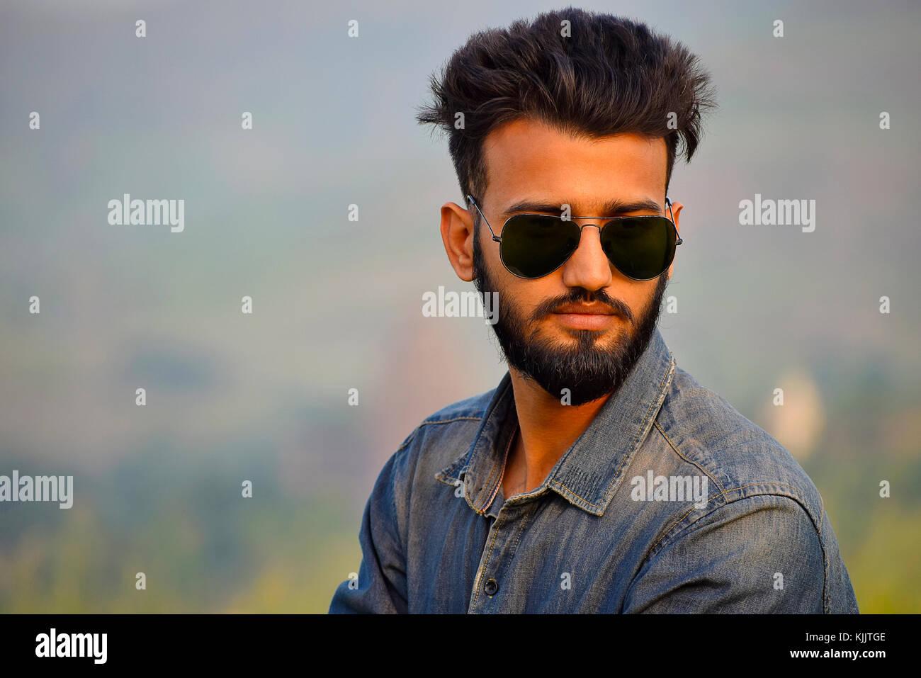 Indian Boy with sun glasses near mountain, Pune, Maharashtra. - Stock Image