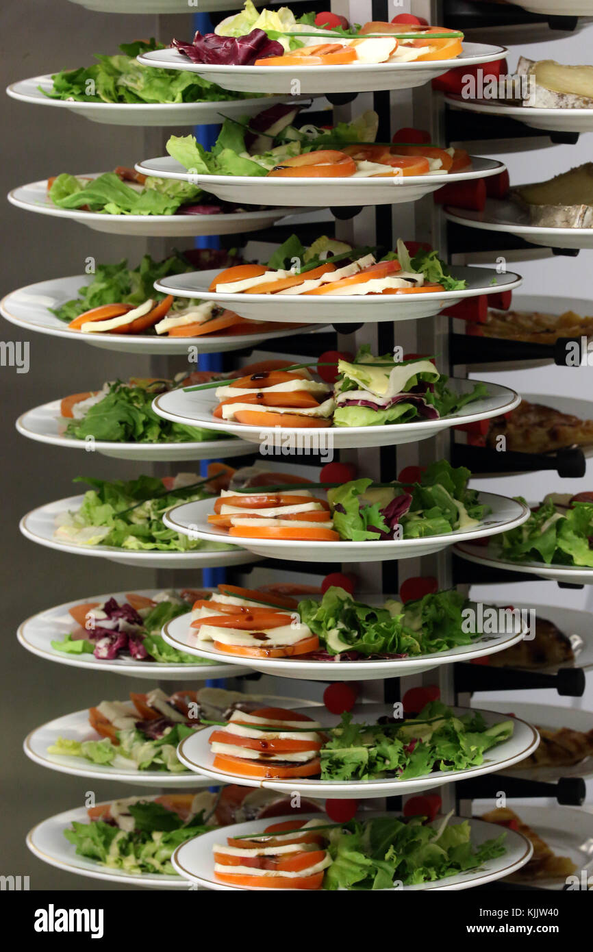 Canteen. Plates with salad.  France. - Stock Image