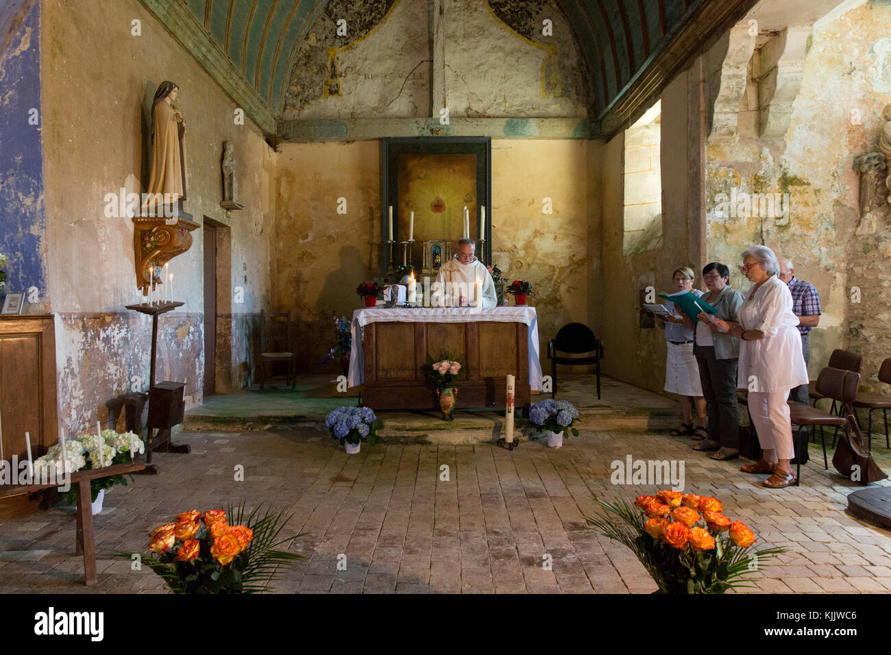 Mass in Champignolles church. - Stock Image
