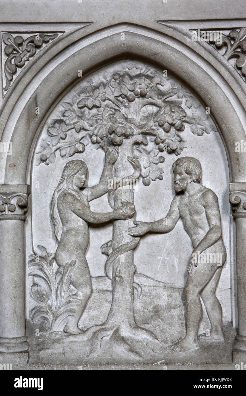 St Martin's catholic church, Villers sur Mer, France. Relief. Adam and Eve. - Stock Image