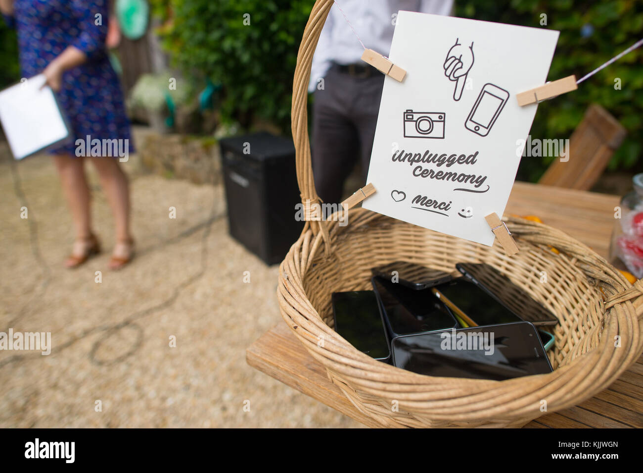 Cell phone basket. France. - Stock Image