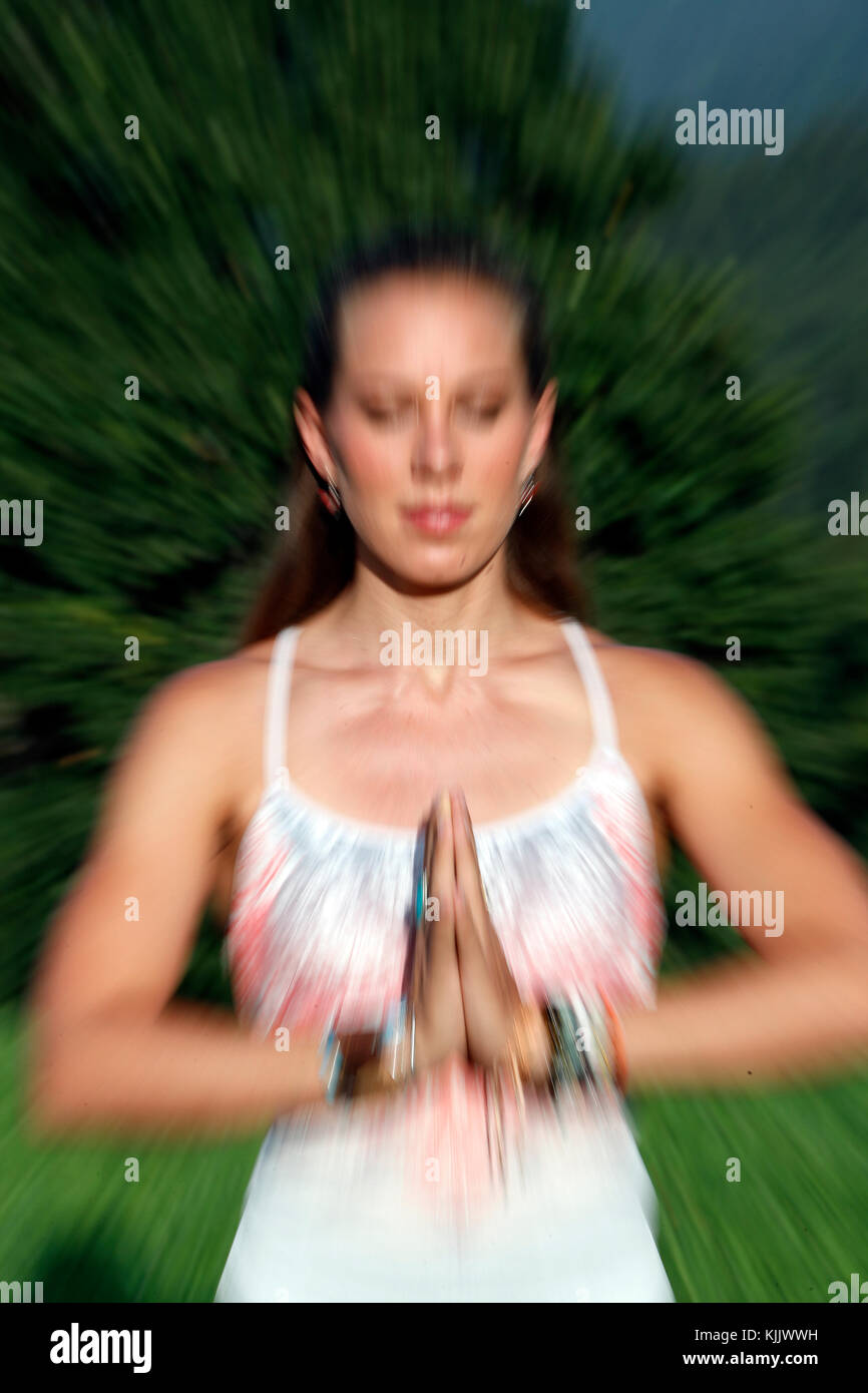 Blurred Motion Of Young Woman Practicing Yoga.  France. - Stock Image