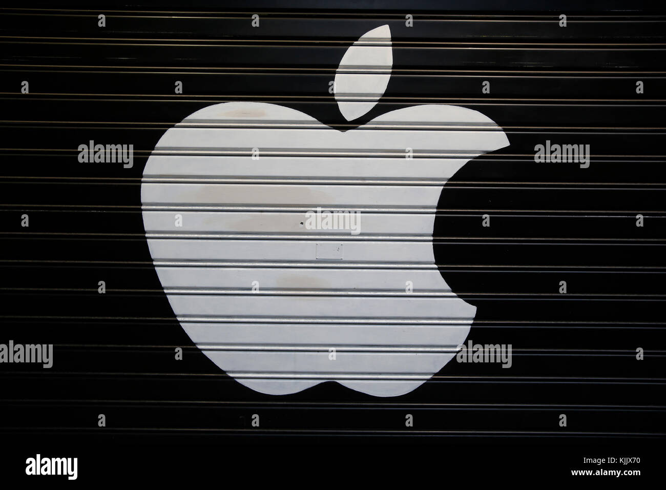 Apple logo on a shop front. Italy. - Stock Image