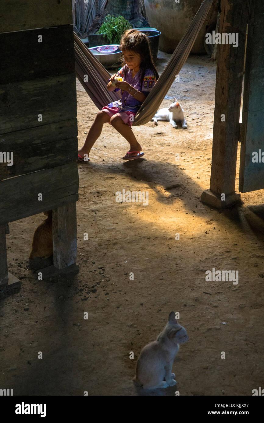 Khmer girl in a hammock. Battambang.  Cambodia. - Stock Image