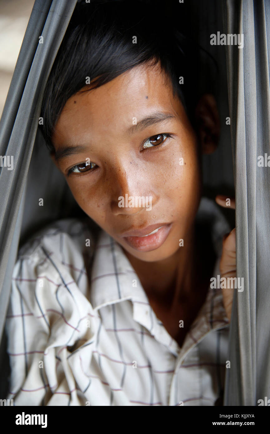 Young Khmer in a hammock. Battambang.  Cambodia. - Stock Image