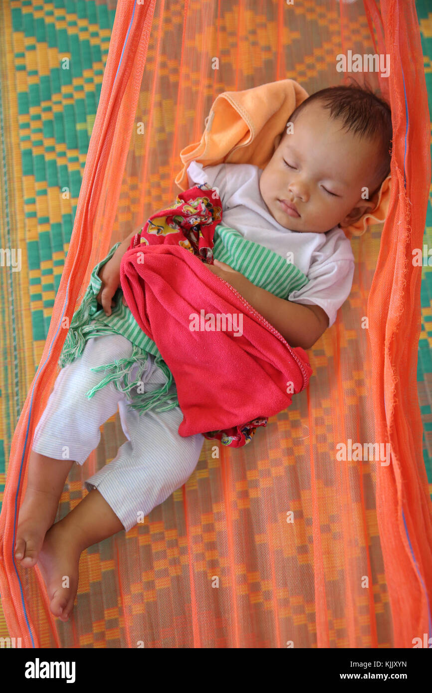 Baby sleeping in a hammock. Battambang.  Cambodia. - Stock Image