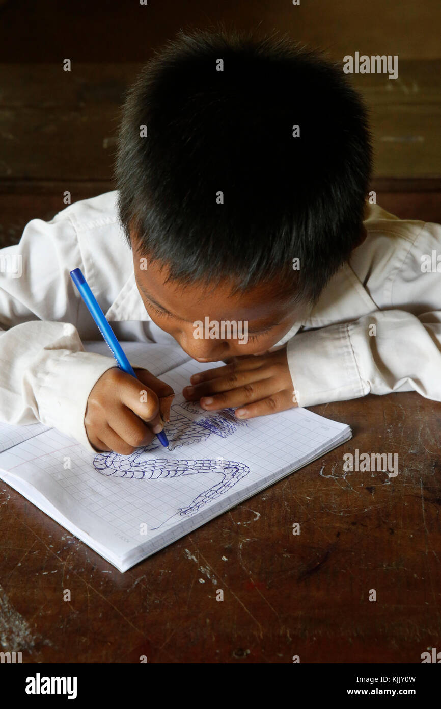 Cambodian schoolboy drawing. Battambang.  Cambodia. - Stock Image