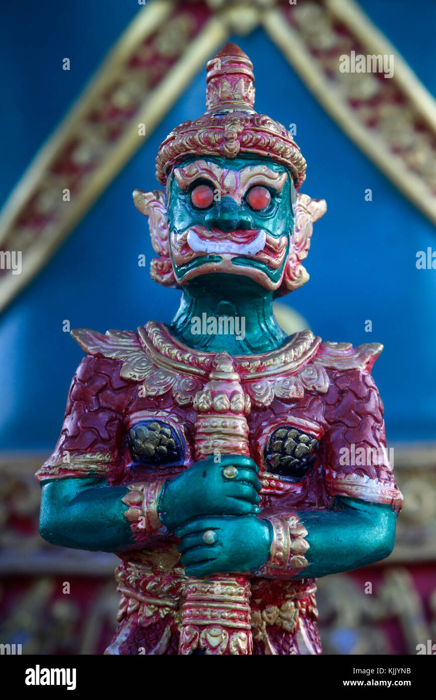 Yak figure (representing a giant with big teeth to ward off spirits or demons) guarding the bot entrance of Wat - Stock Image