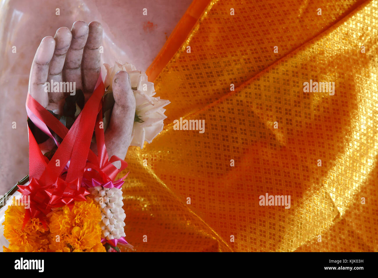 Detail of a garlanded Buddha statue in Wat Phra Doi Suthep, Chiang Mai. Thailand. - Stock Image