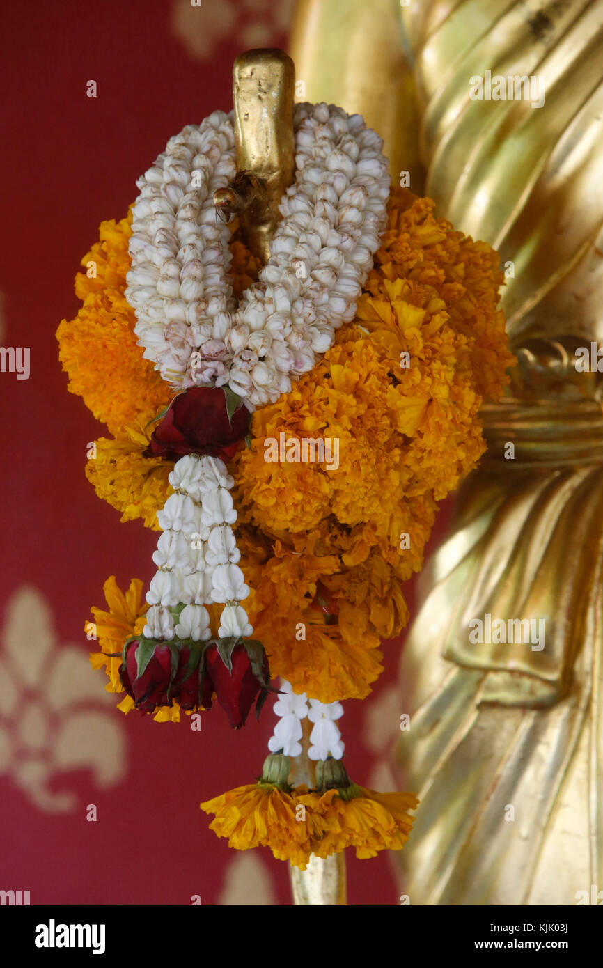 Detail of a garlanded Buddha statue in Wat Chedi Luang, Chiang Mai. Thailand. - Stock Image