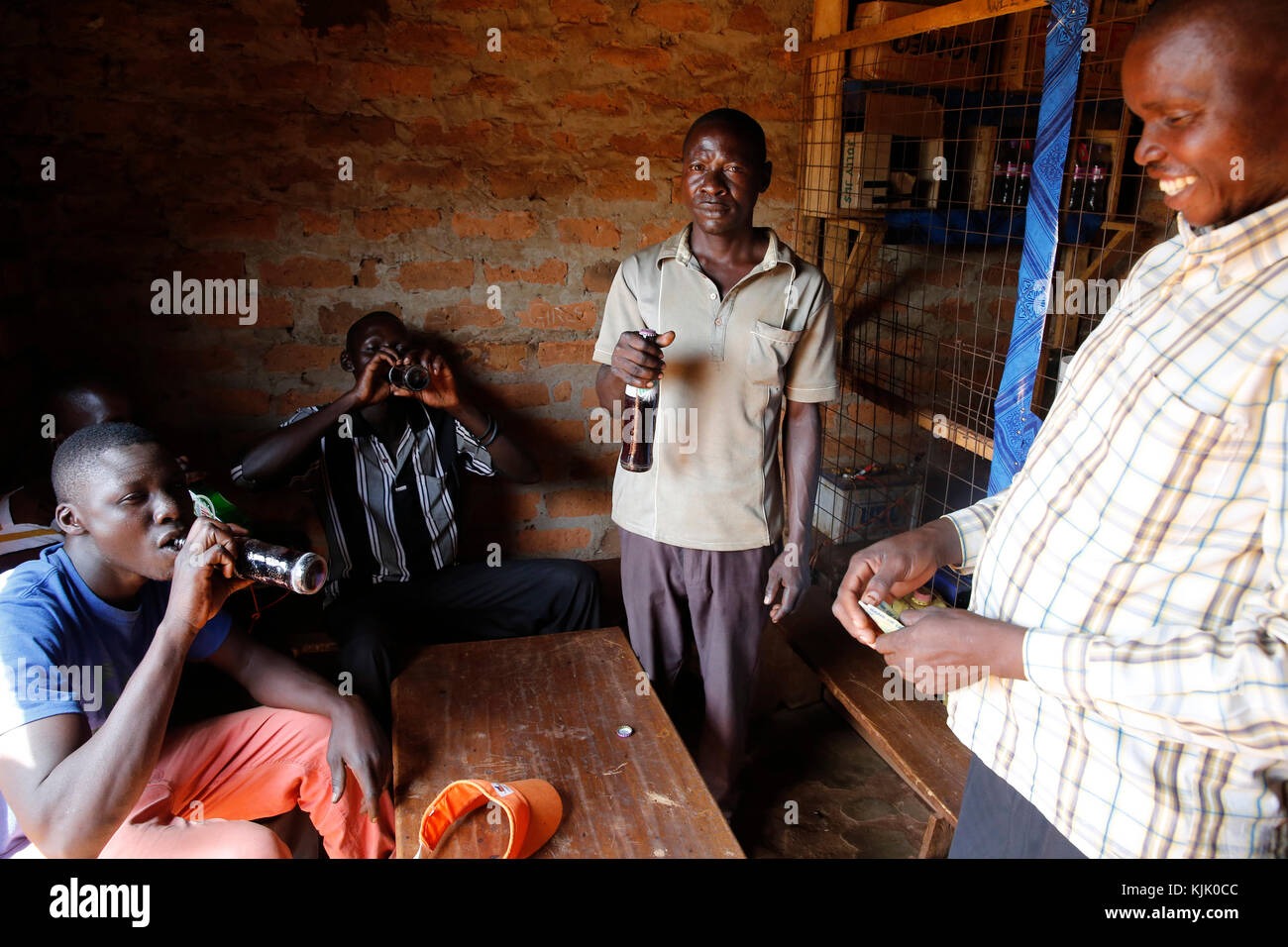 Dennis Openji owns a bar and drink shop in Katulikire. He received 3 loans from Kolping Uganda. Uganda Stock Photo