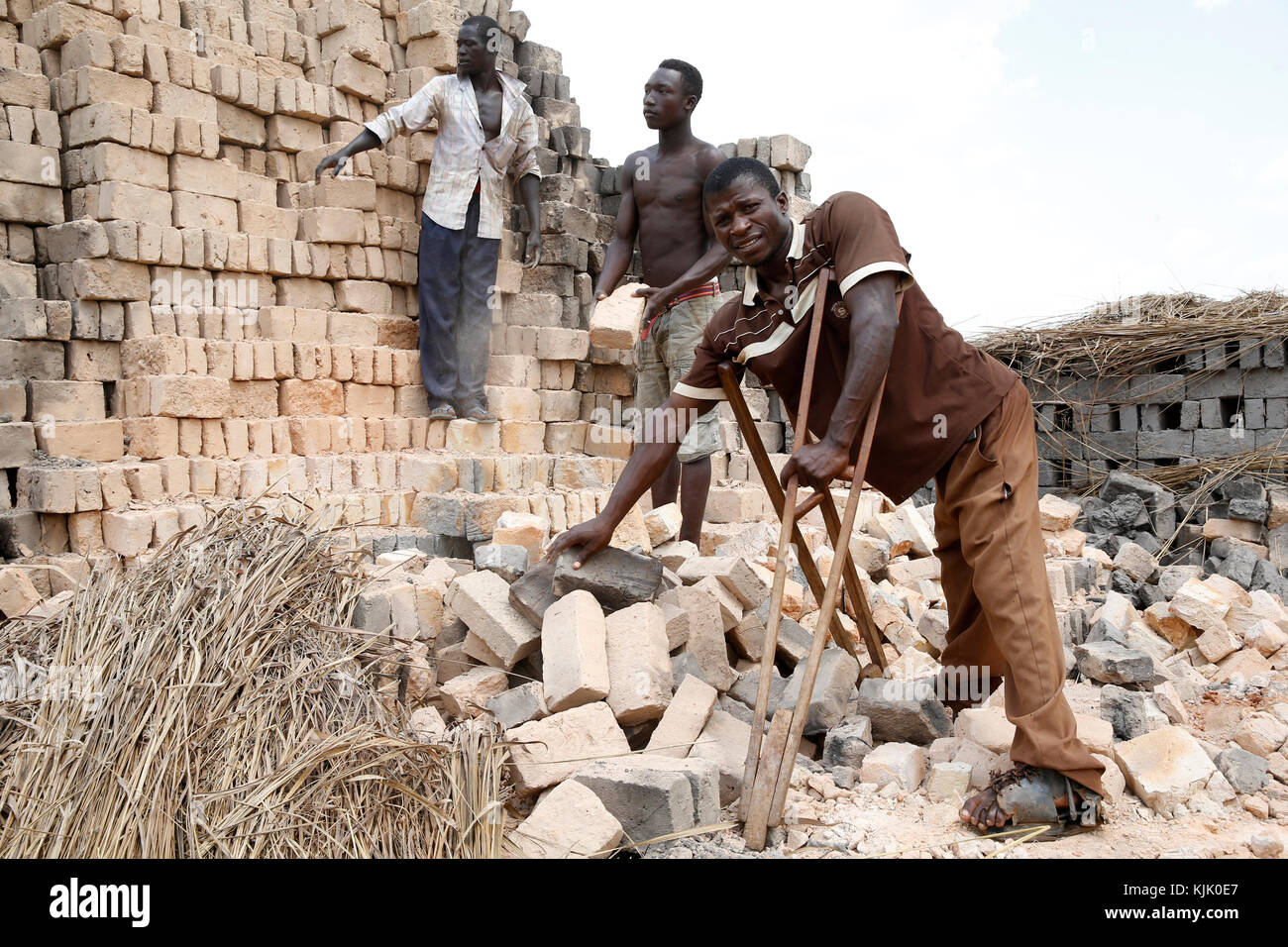 Charles Barikrungi received 4 loans from ENCOT Microfinance. He employs 20 workers on his brick factory. Uganda - Stock Image