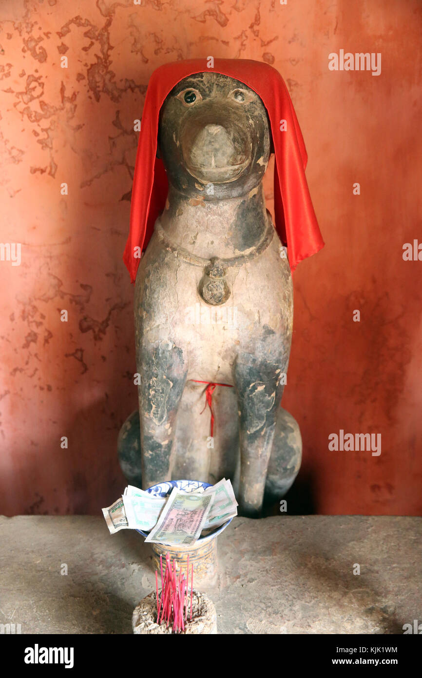 The Japanese Covered Bridge or Cau Chua Pagoda. Dog statue. Hoi An. Vietnam. - Stock Image