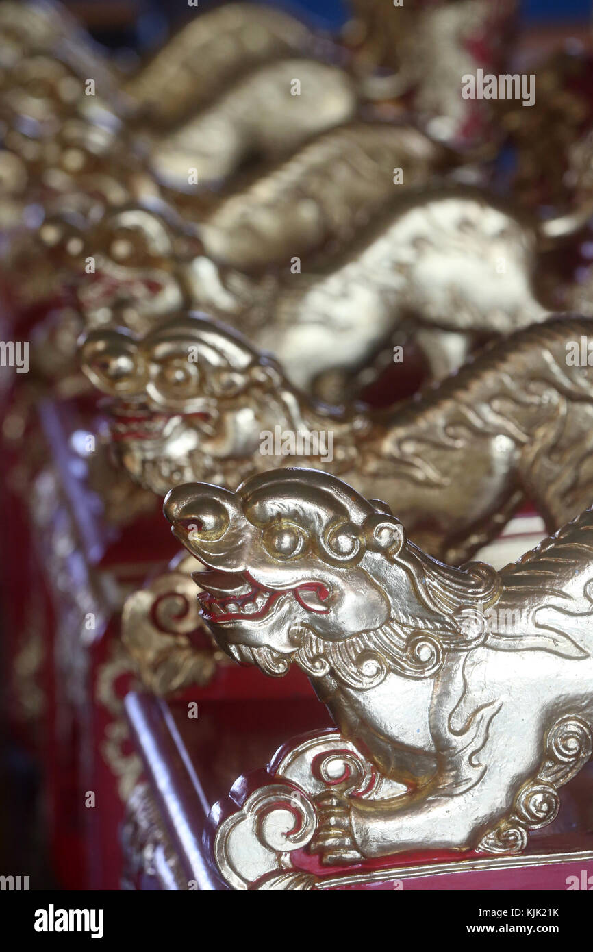 Cao Dai Holy See Temple.  Detail of arm chair with golden dragons. Thay Ninh. Vietnam. - Stock Image