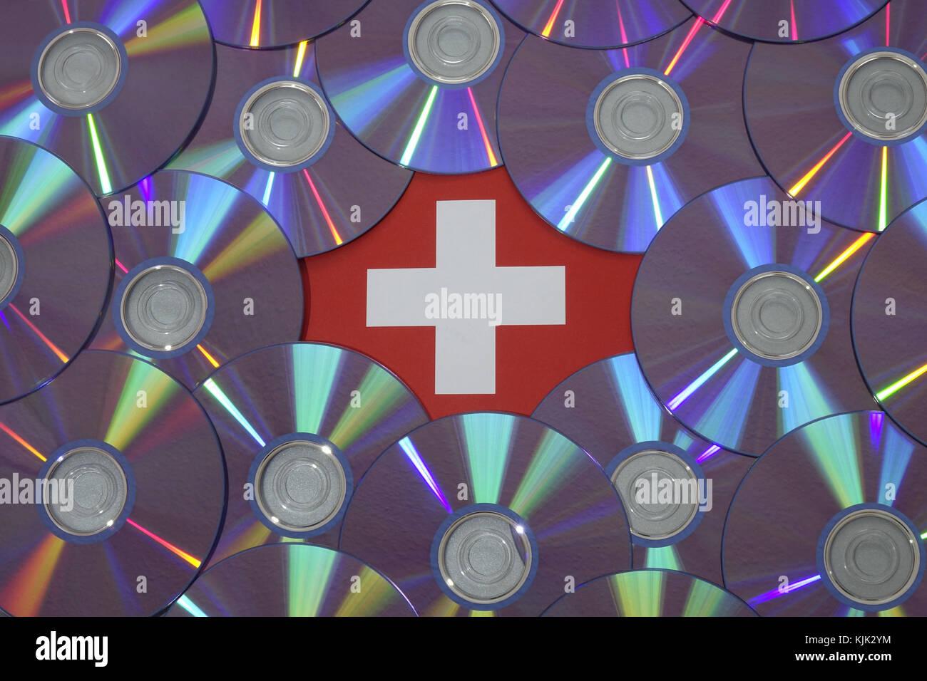 ILLUSTRATION - A Swiss flag under several CDs, 07.05.2017. - NO WIRE SERVICE - Photo: Sascha Steinach/dpa-Zentralbild/dpa Stock Photo