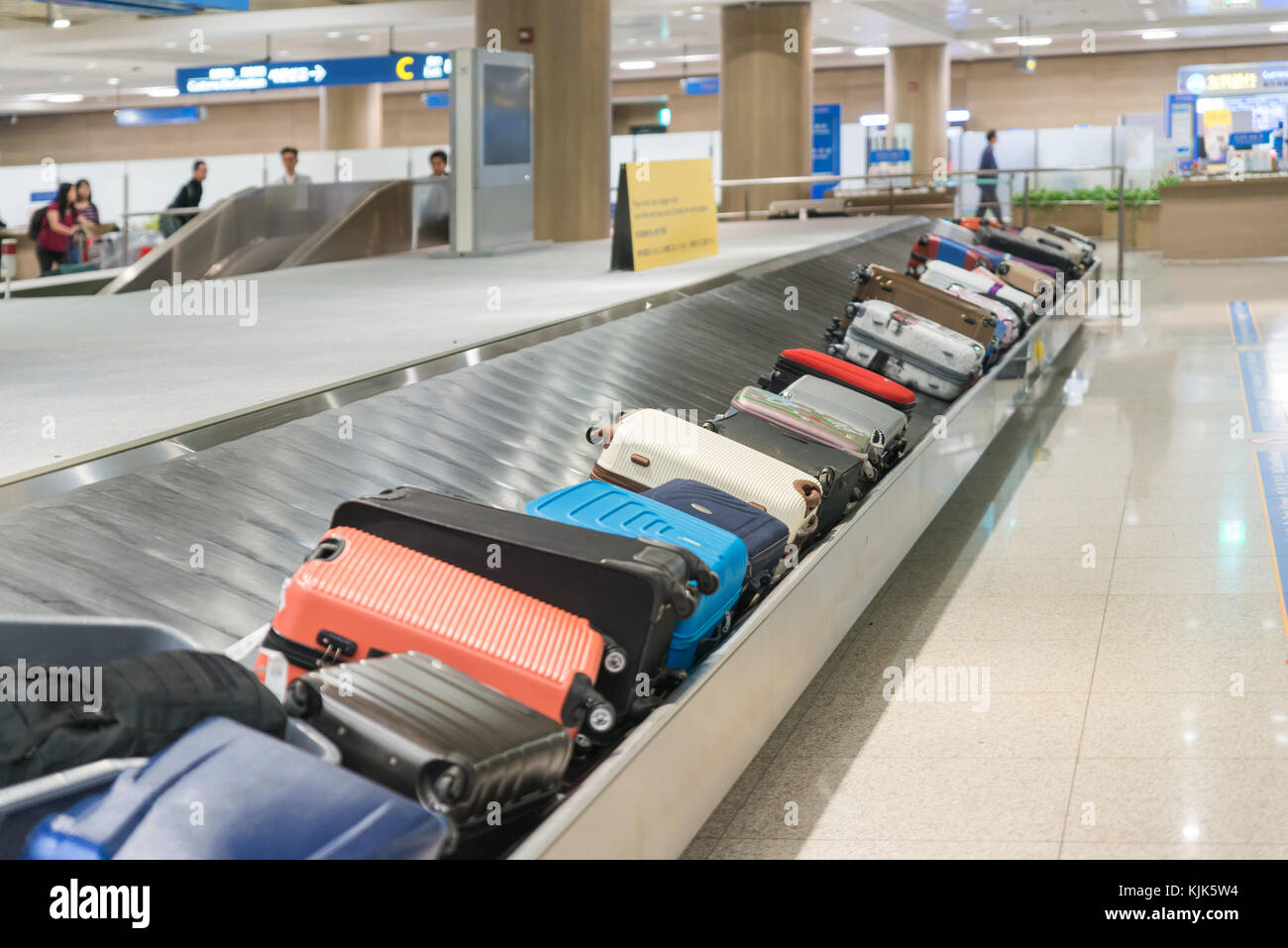 Suitcase or luggage with conveyor belt in the airport. - Stock Image