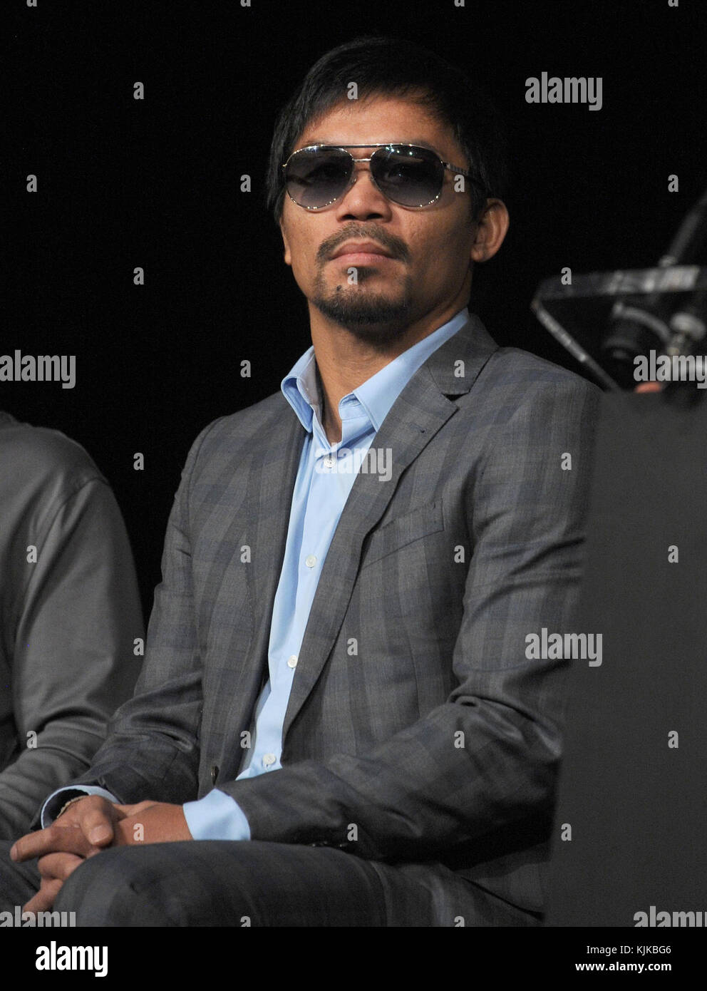 NEW YORK, NY - JANUARY 21: Boxing's pound-for-pound superstars, Congressman Manny Pacquiao and Timothy Bradley - Stock Image