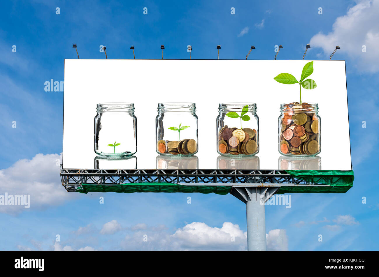 Billboard on beautiful sky showing the Gold coins and seed in clear bottle on white background,Business investment - Stock Image