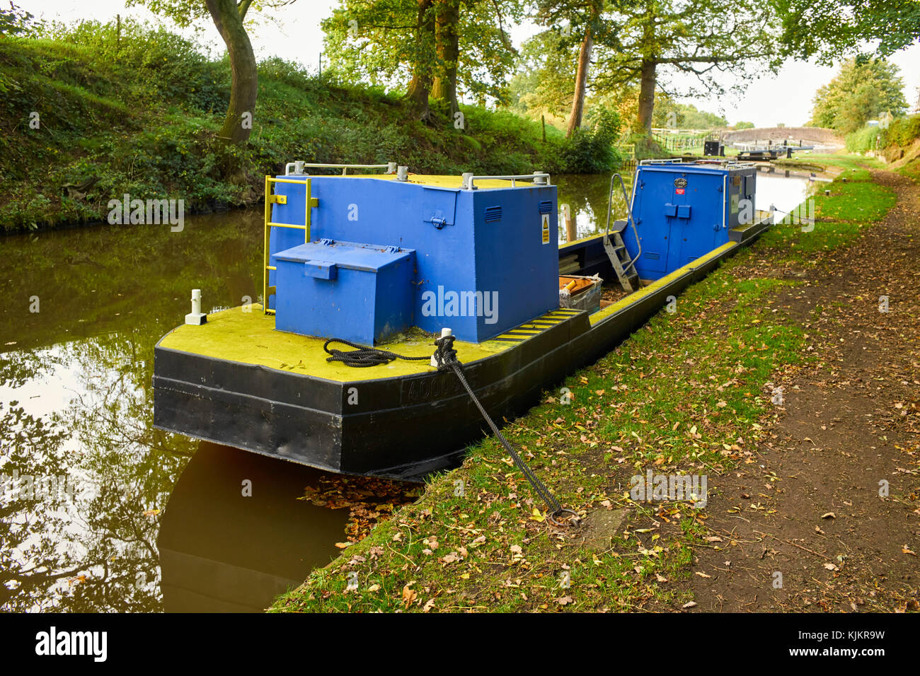 Canal and River Trust workboat Churnet at lock 1 Audlem, Cheshire - Stock Image