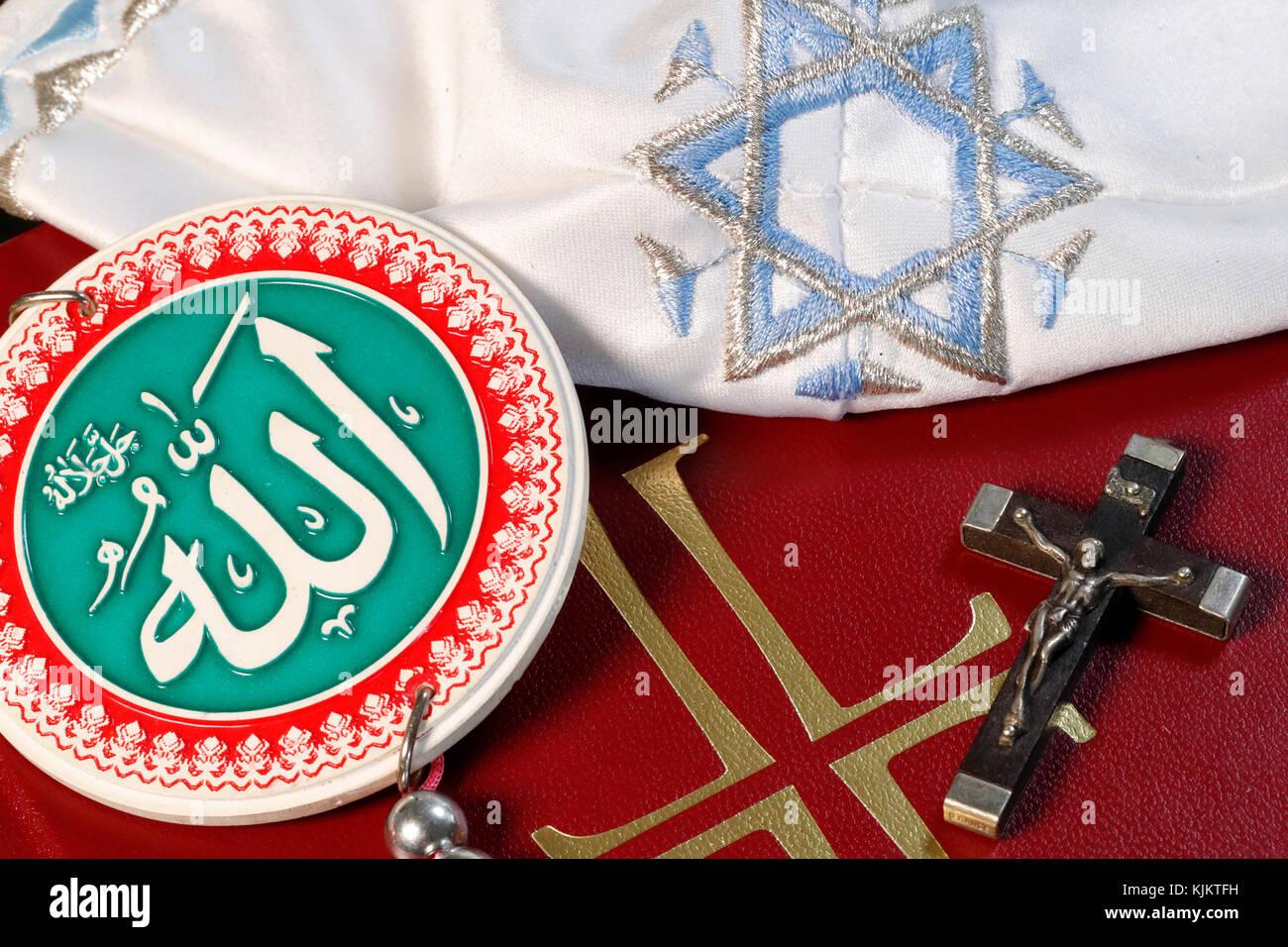 Christianity Islam and Judaism : 3 monotheistic religions. Interfaith symbols : bible, crucifix, Allah Monogram, - Stock Image