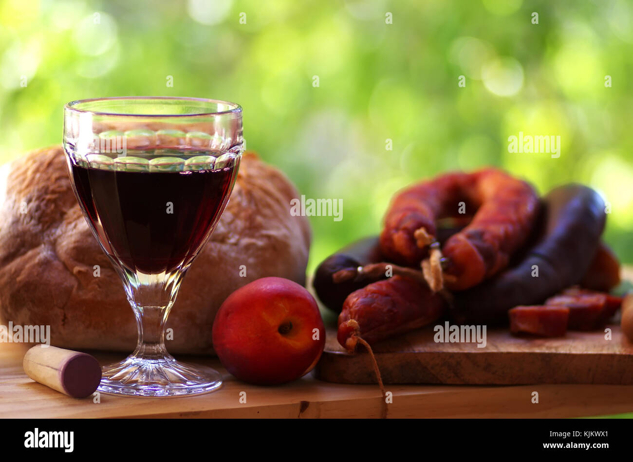 Red wine, chourizo and bread on table Stock Photo