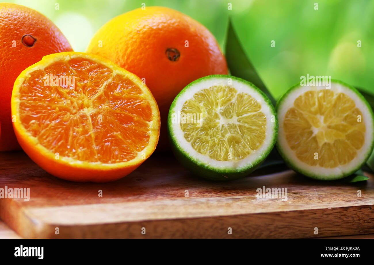 ripe and green oranges on table Stock Photo