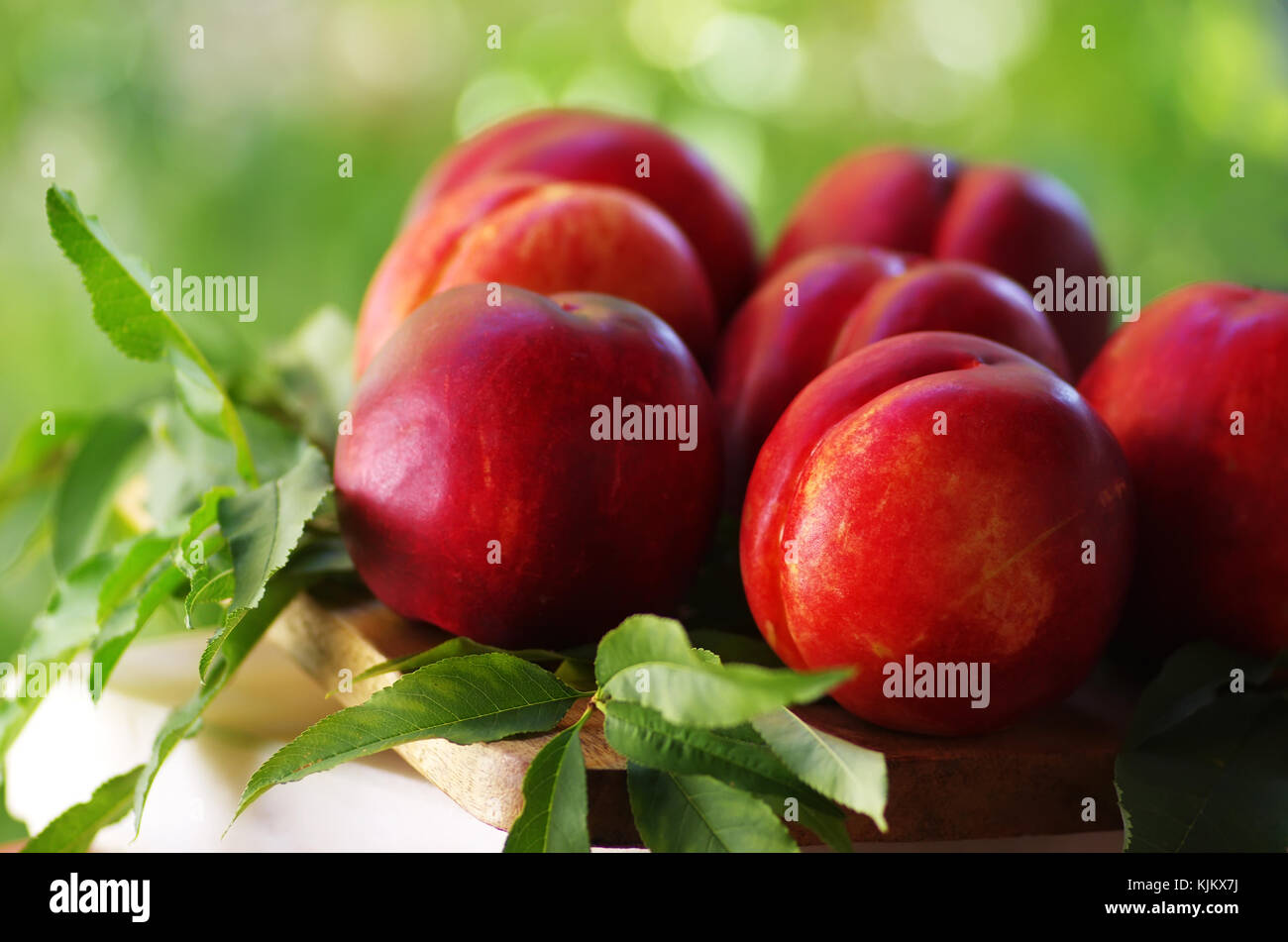 a group of ripe peaches on table Stock Photo