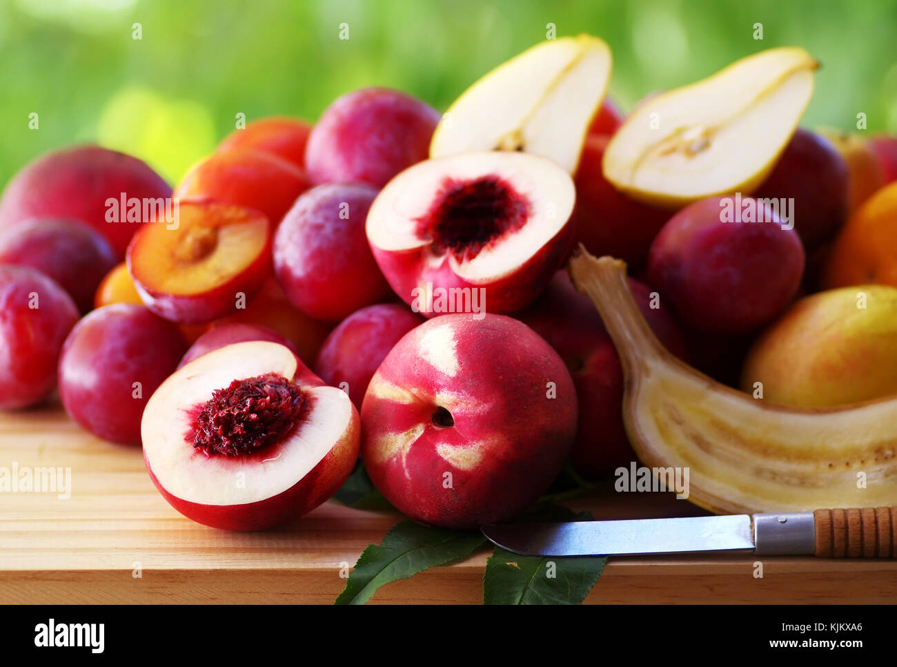 ripe nectarines and plums on table Stock Photo