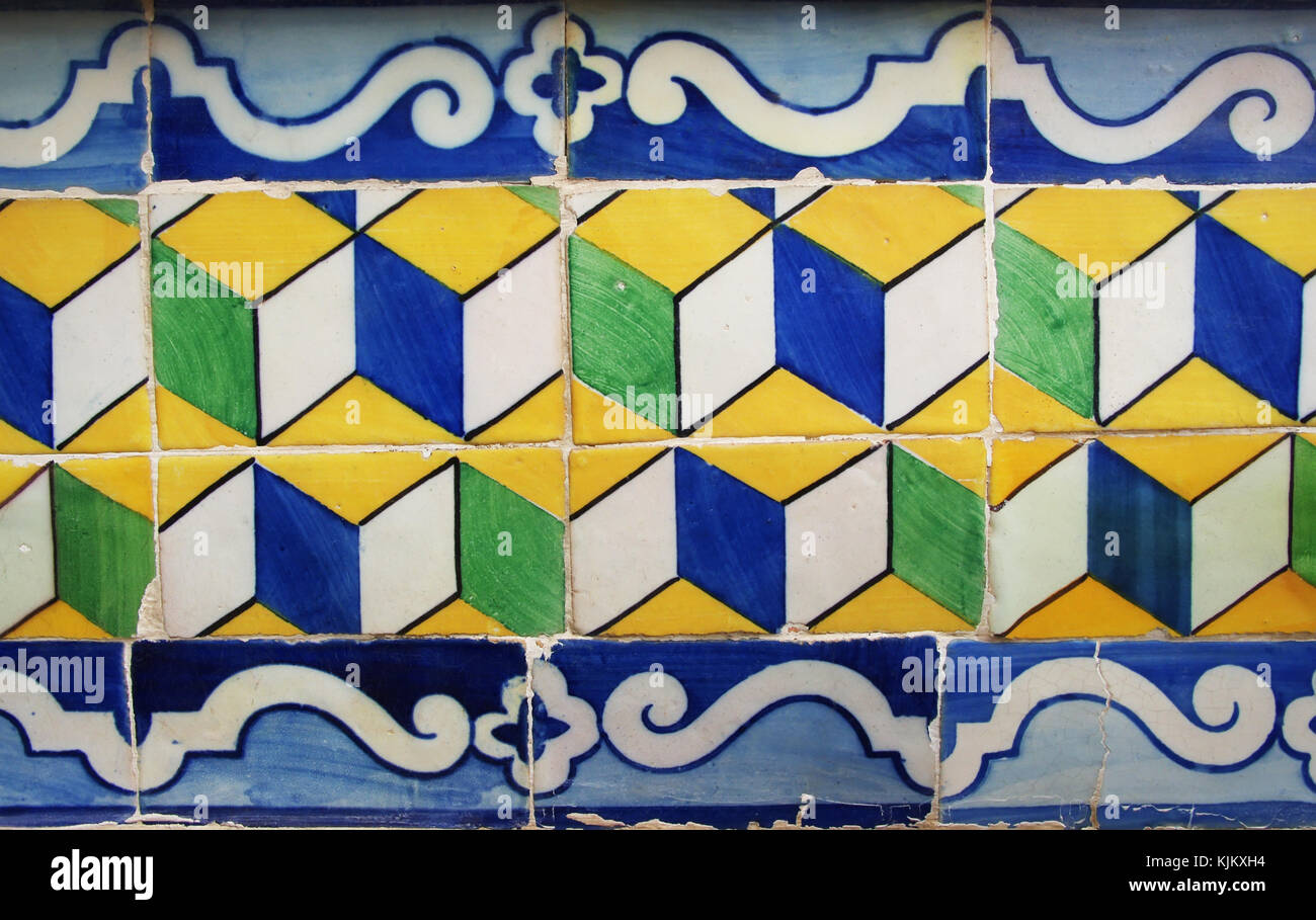 Blue, yellow and green Portuguese tiles (azulejos) with geometric pattern Stock Photo