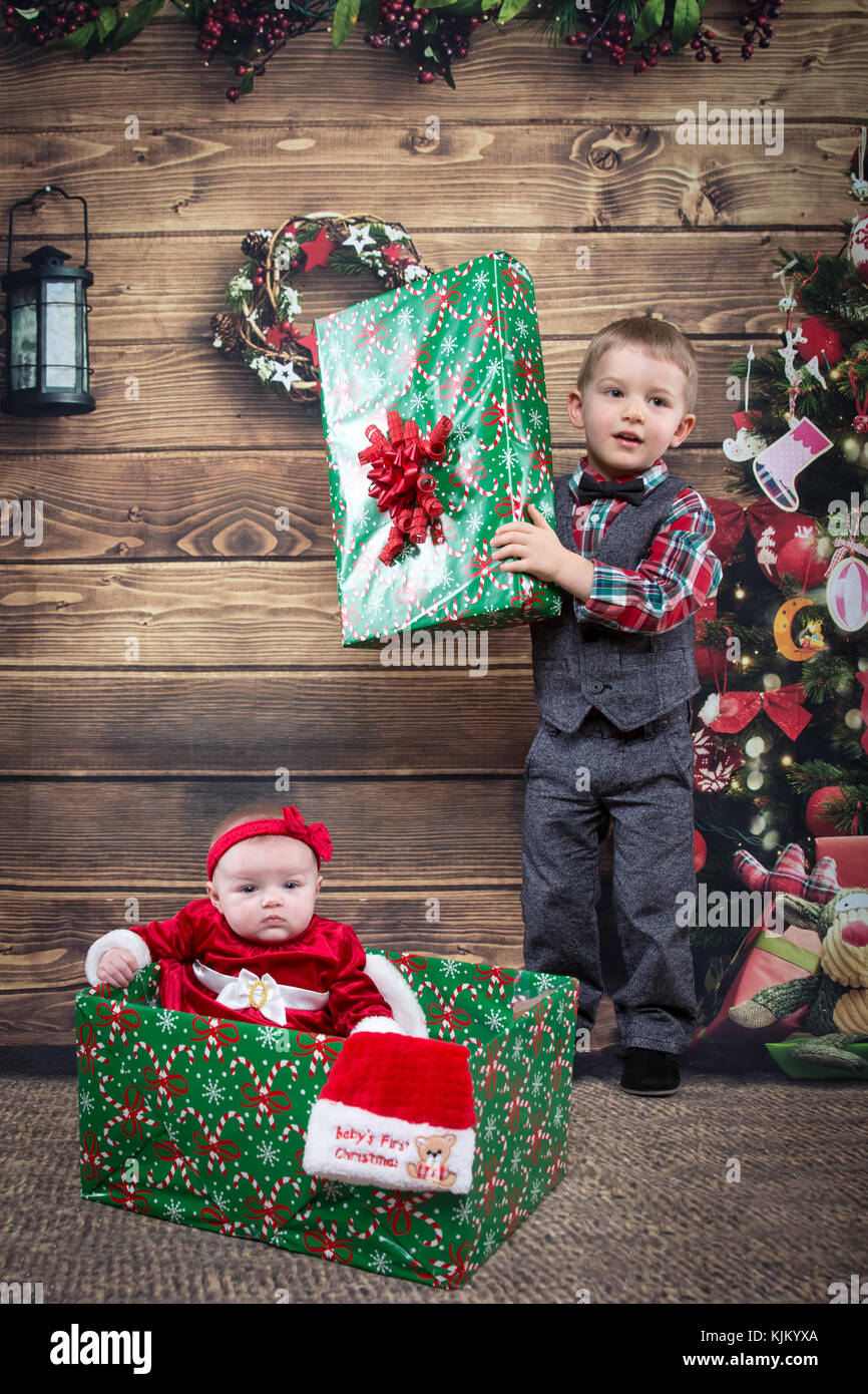brother opening Christmas gift- baby sister Stock Photo: 166396114 ...