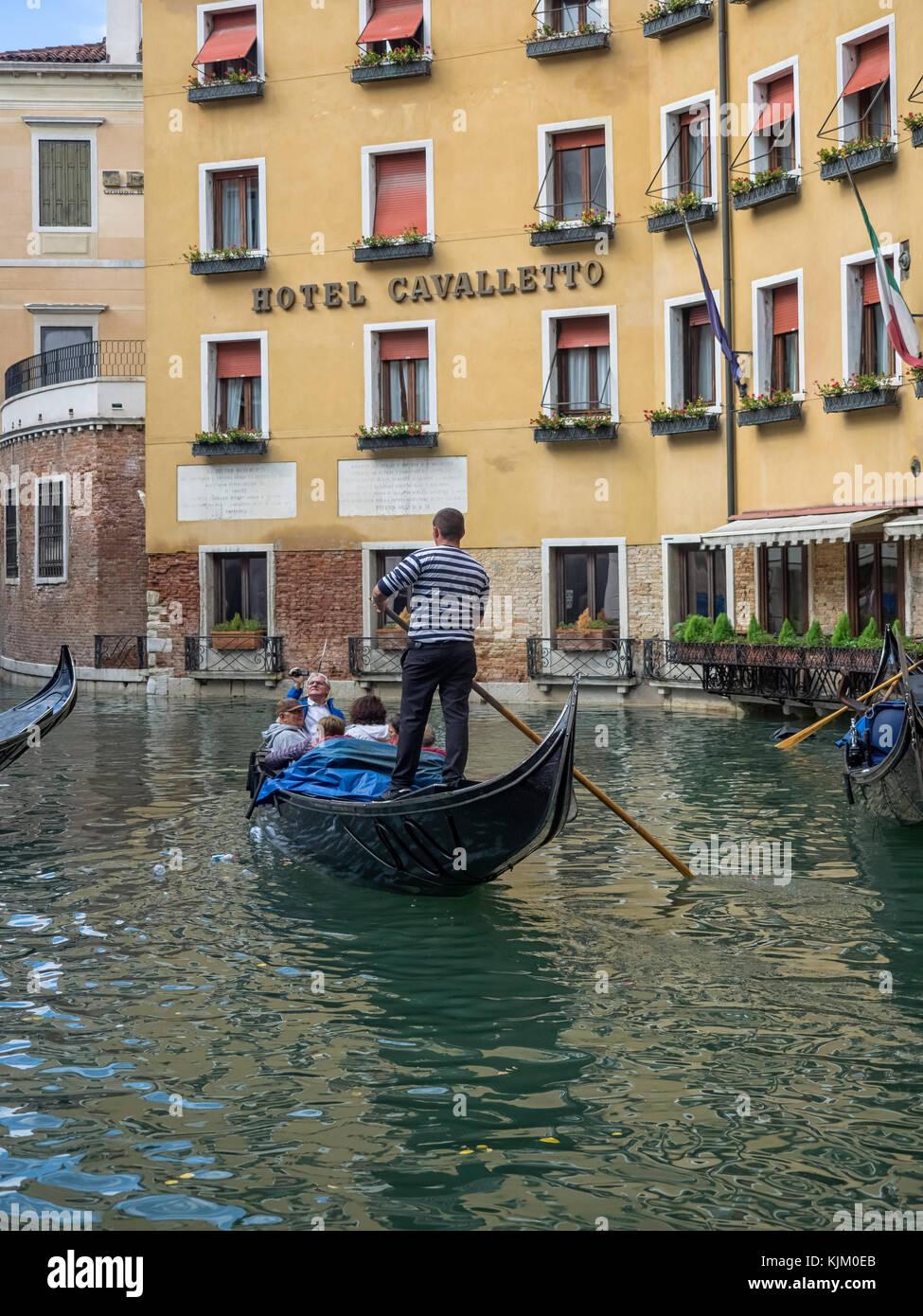 VENICE, ITALY:  Gondola in front of the Hotel Cavalletto facing Bacino Orseolo. - Stock Image