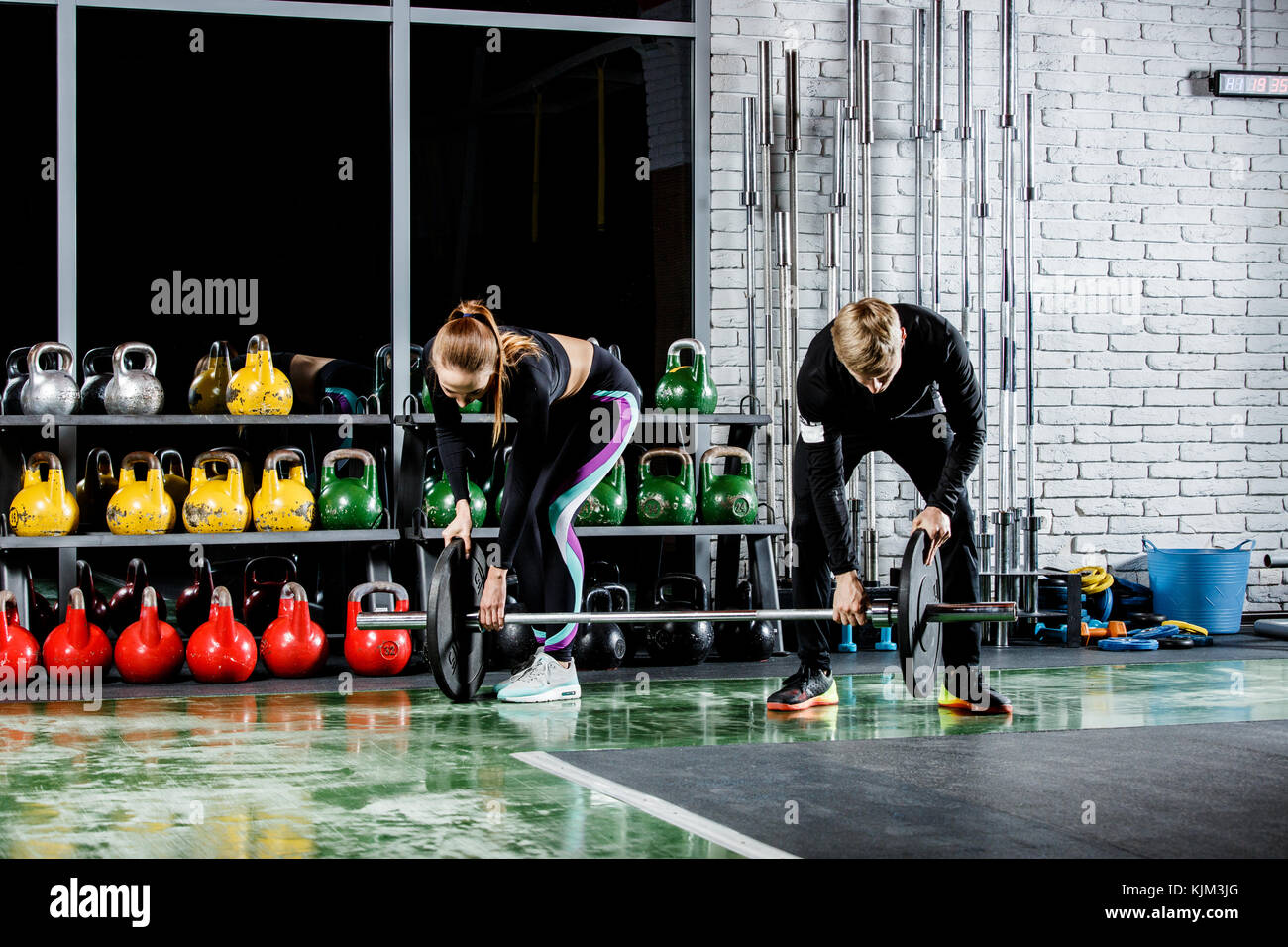 the young girl is getting ready for the exercise with the trainer - Stock Image