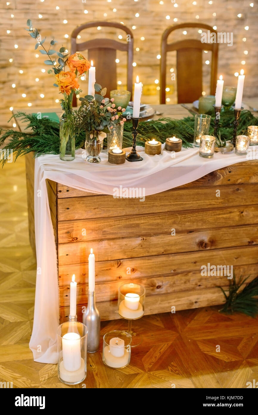 dining, evening, wedding concept. place in the restaurant for newly wed couple, it is decorated with varios plates, - Stock Image