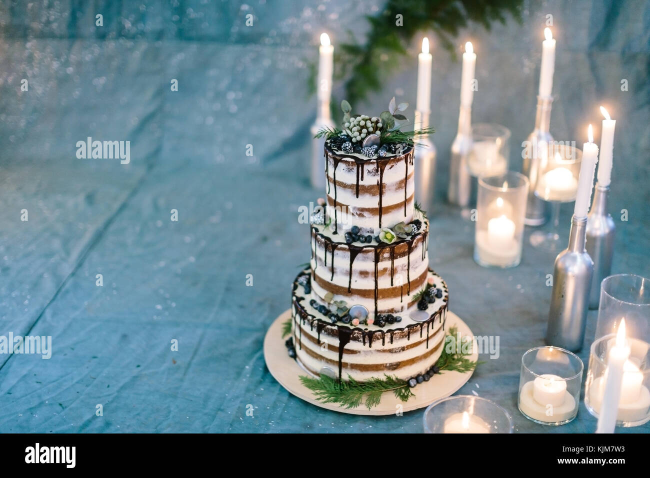 confectionary, dessert, party concept. marvelous cake composed of three tiers, all of them carefully decorated with Stock Photo