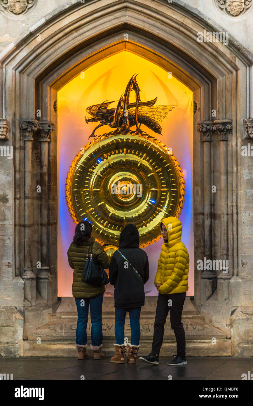 The Corpus Christi Clock with the Chronophage (or Time Eater)  illuminated at dusk, Kings Parade, Cambridge, England, - Stock Image