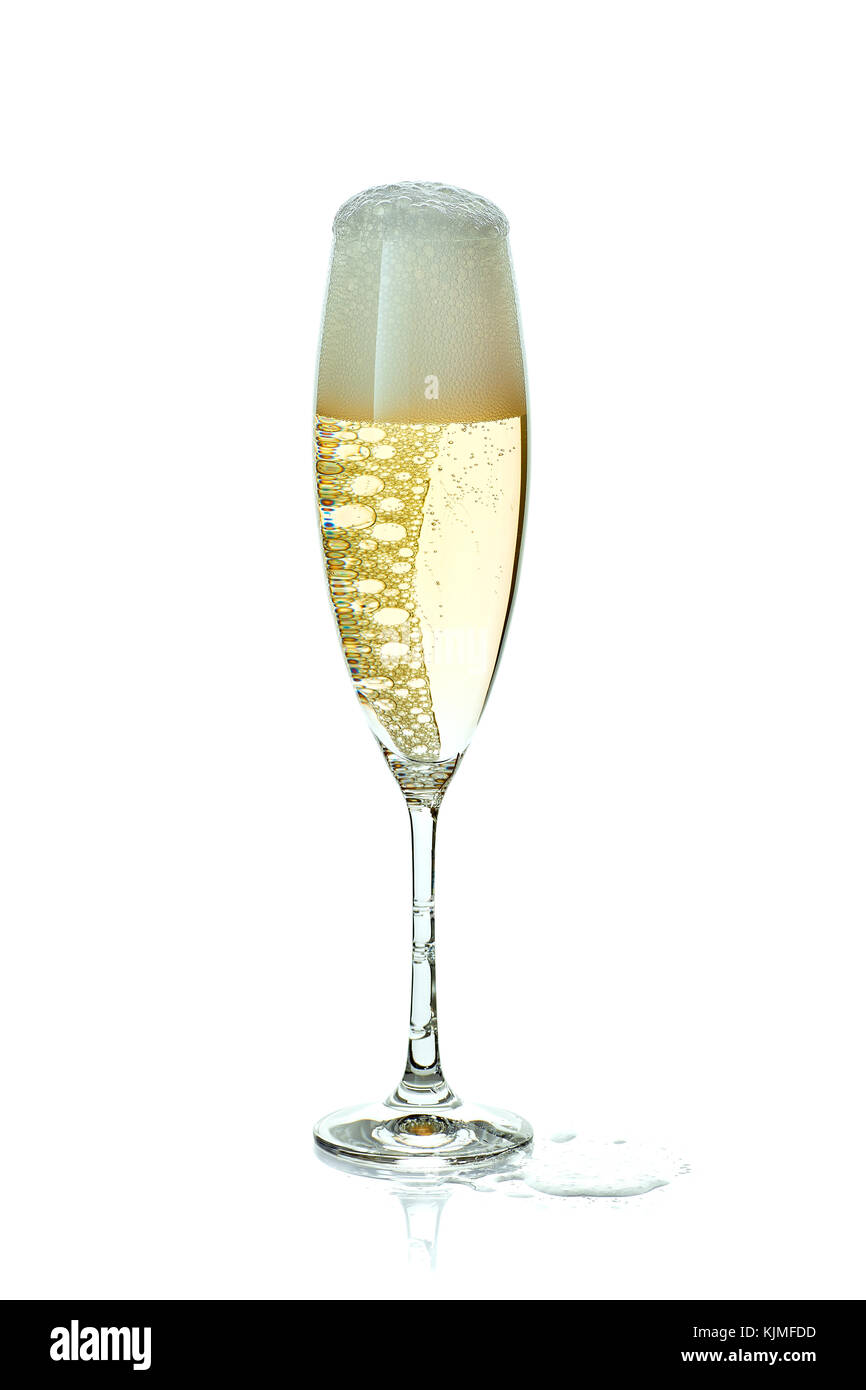 Glass of champagne with foam on white - Stock Image