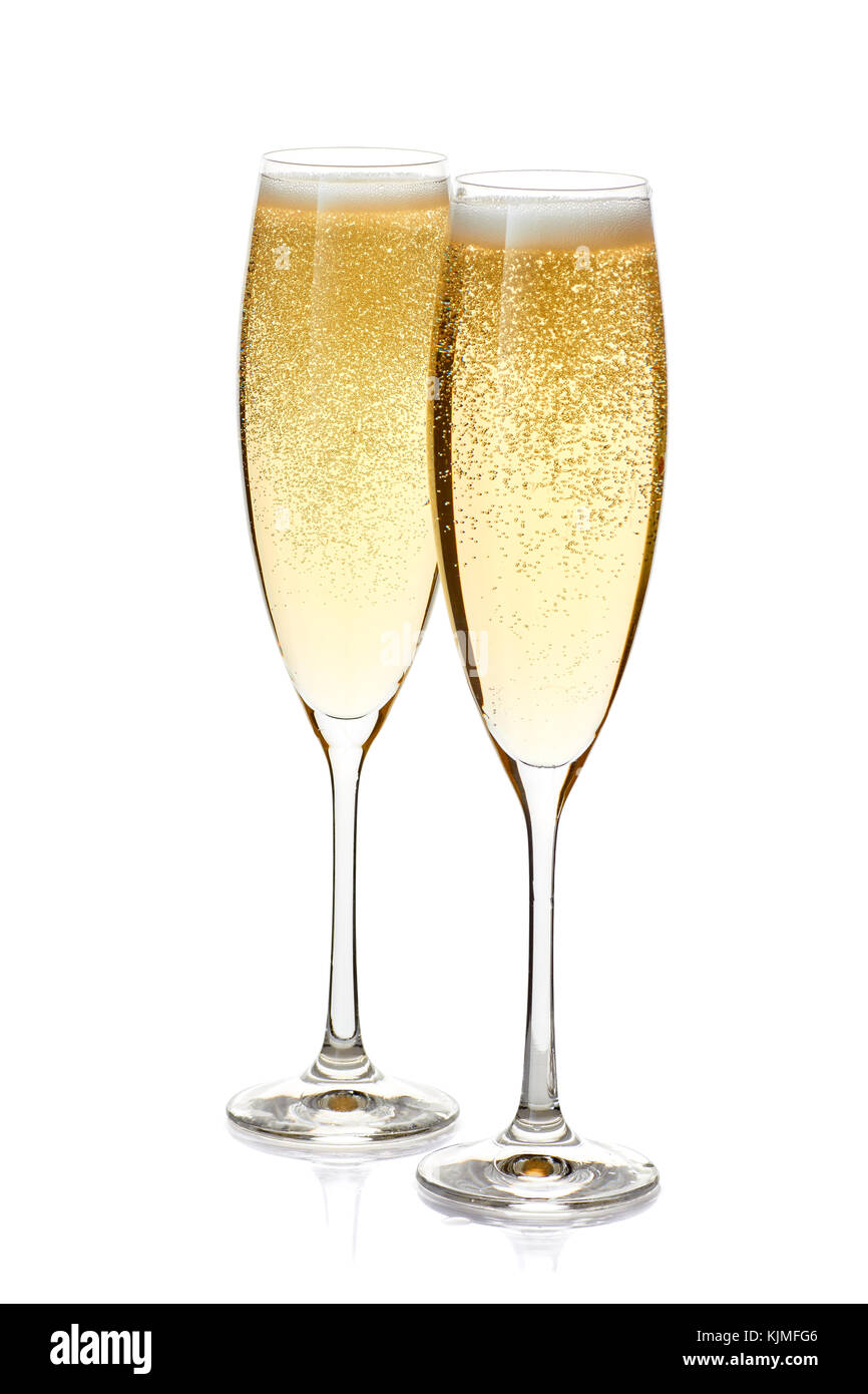 Two glasses of champagne with foam and bubbles on white - Stock Image