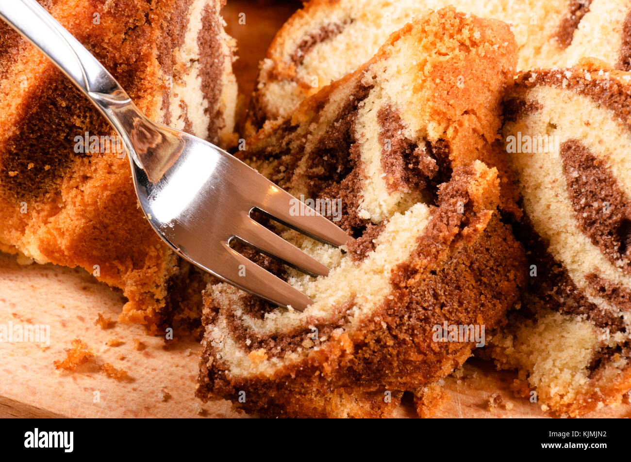 Grabing the cake with fork Stock Photo