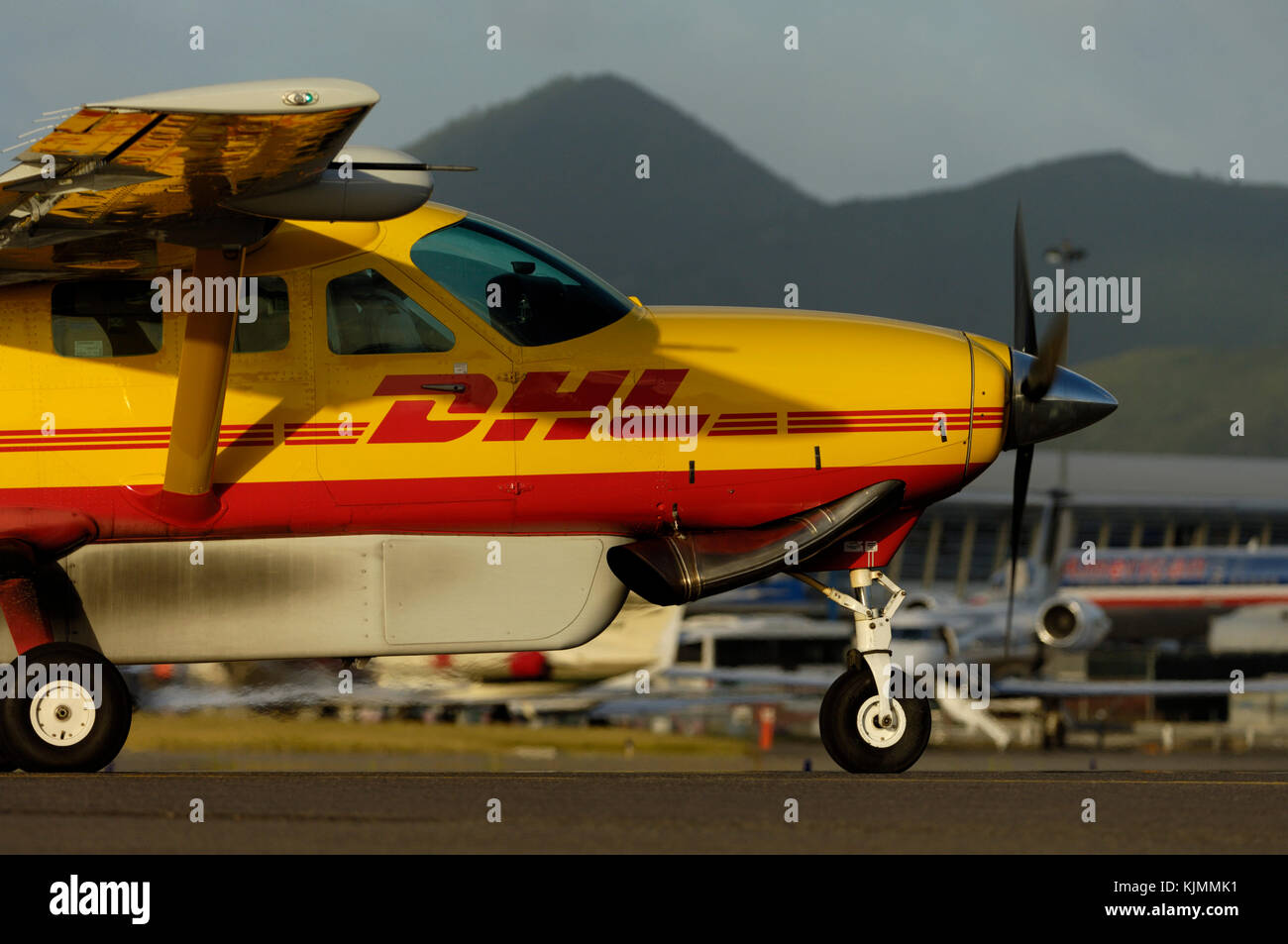 taxiing with a belly-pod, exhaust pipe and hills behind Stock Photo