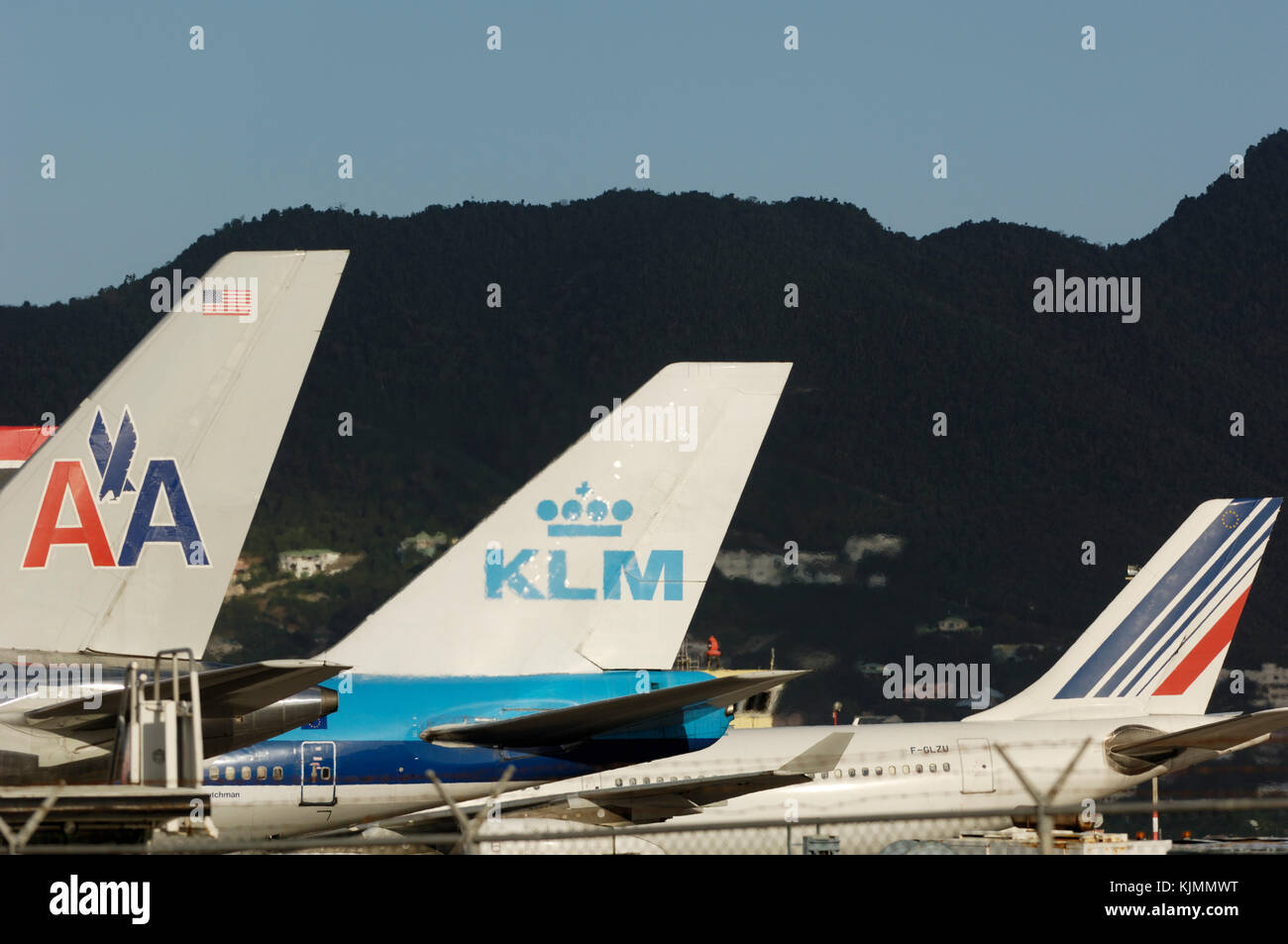 Airliners tail fins, an American Airlines B757, KLM B747 and Air France A340 in a row, on the ground, at Sint Maarten Stock Photo