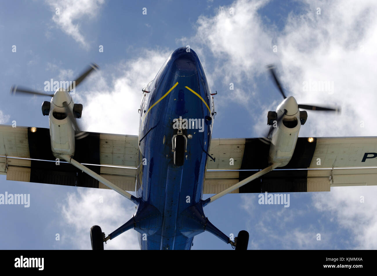 DHC-6 Twin Otter 300  in the air, overhead. A small civil turboprop aircraft. - Stock Image